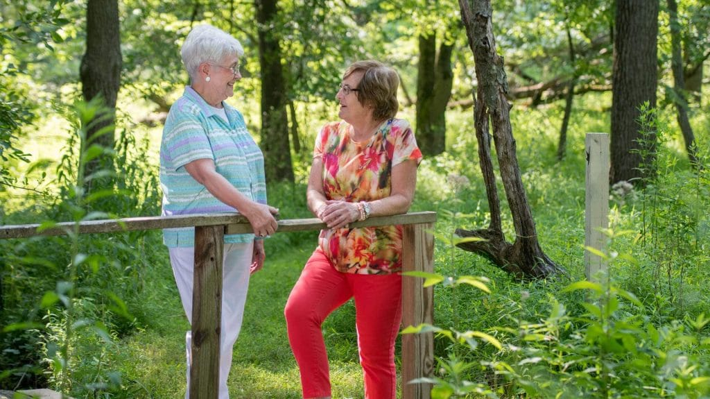 Two women talking while outdoors
