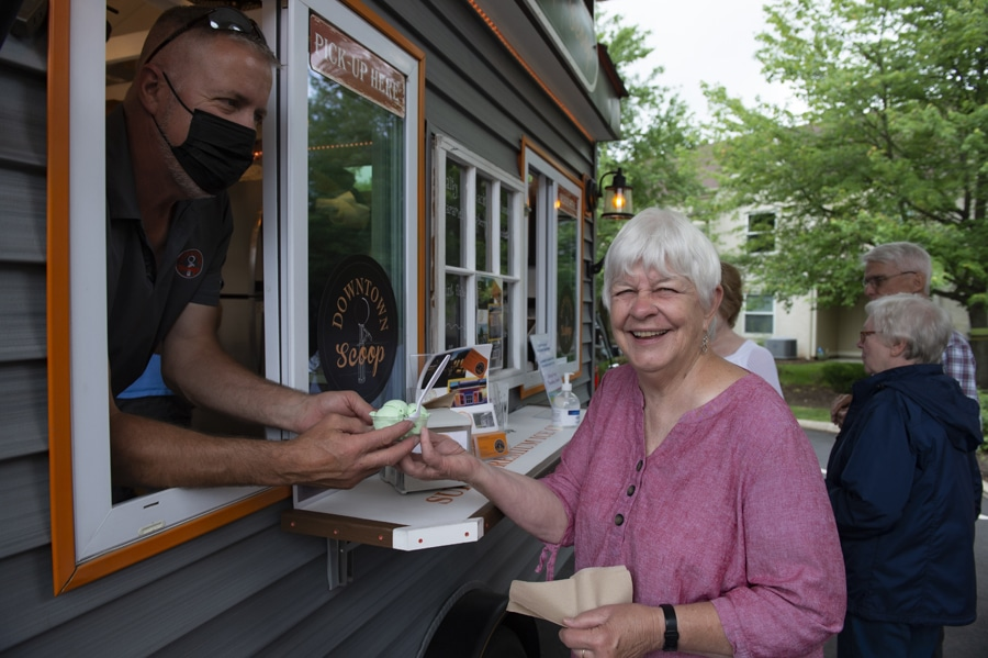 woman getting ice cream from food truck